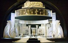 Get yer Oscar spoiler here! No, I'm not talking about Philip Seymour Hoffman's virtual lock on Best Actor (sorry, Heath!), and alas, I'm not privy to any of Jon Ste… Design Set, Design Model, Concert Stage Design, Model Maker, Theatre Stage, Theatre Design, Stage Decorations, Stage Set, Scenic Design