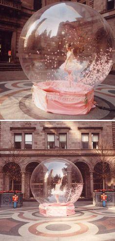 Ballerina in a snow globe - performance art
