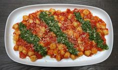 Gnocchi with arugula pesto and squishy tomatoes