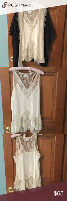 2 piece set - lace tank and black/cream kimono. Both pieces are Free People- the lace V neck tank is a size M. Stunning lace details. Never worn. The Black and Cream Kimono is one size fits all. This outfit can be worn together or a part. The Kimono is NWT. The V Neck tank can fit a size 8/ 10. The Kimono is one size fits all. Free People Tops