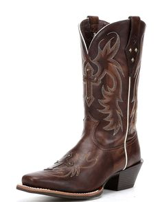<p>Town or country - this good ol' cowgirl boot works hard, but knows how to have a good time. This head turning boot features a cross overlay with stud accents on the foot and upper. With a sporty square-toe and tons of colors, there's a Legend with your name on it. </p>