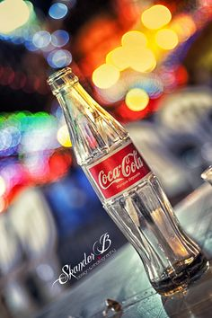 An empty Coca Cola bottle  - photo by Skander Benmohammed