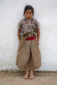 Young girl in traditional dress. San Juan Chamula, Mexico. tom robinson photography.