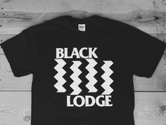 This is a mash up design, combining the floor of the black lodge in the television show TP with the iconic logo of the punk band Black Flag.  It