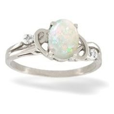 I love the silver and white combination.  The opal looks like it is set in a heart.
