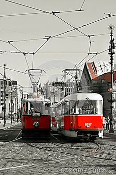 View of the historical and newer tram in Prague.  A tour of in Prague for tourists.  Color adjustment black, white, red.