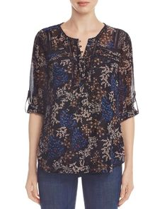 Daniel Rainn Floral Print Blouse | Self & lining: polyester | Hand wash | Imported | Fits large | Crewneck with partial button placket, roll-tab sleeves, pleated front, floral print | Side slits at he