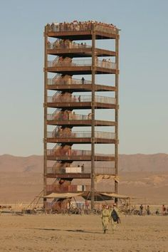 Constructed in the Babylon Art Installation was a 100 foot tall steel tower with a photo booth on the ground that projected images taken during the day onto the tower by night. Nevada, Man Photo, Photo Art, Babylon Art, Michel Fugain, Burning Man Art, Black Rock Desert, Burning Man Fashion, Effigy