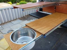 Work bench extended with sink fitted