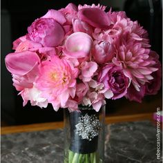 Pink dahlias, hydrangea and tulips, fuchsia calla lilies, and Yves Piaget garden roses, wrapped in black ribbon with a rhinestone brooch