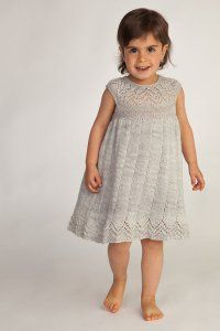 Knitting pattern for Muti Dress for baby and toddler with lace collar and hem