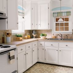 Budget kitchen remodel with pristine white cabinets and light blue accents