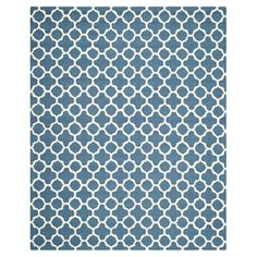 Wool rug with a trellis motif. Hand-tufted in India.   Product: RugConstruction Material: 100% WoolC...