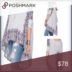 Free people spring asymmetrical tunic ➖BRAND: Free People  ➖SIZE: XS  ➖STYLE: Pick me up Tee : A paisley print gives this tunic a Boho Chic look. The hankerchief hen is also asymmetrical. This tunic is absolutely perfect for the spring ➖MATERIAL: 66% rayon 34% polyester  ❌NO TRADE 345302 Free People Tops Tunics