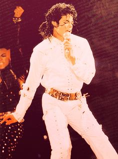 Michael Jackson BAD Tour (one attire)- All white jump suit with gold belt and buckles. Long sleeve shirt with buttons and pants with buttons