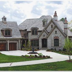 Love the old grey stone with the dark reddish brown garage doors.