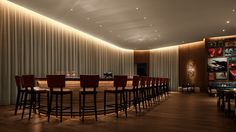 A solid walnut floating bar is the centerpiece at Matador Bar.