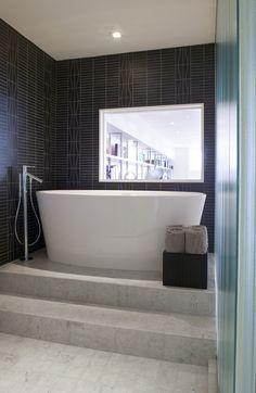 Raised bathtub, modern bathroom