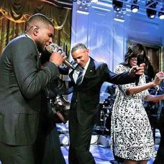 President Obama and Michelle Obama kicking it with Usher.