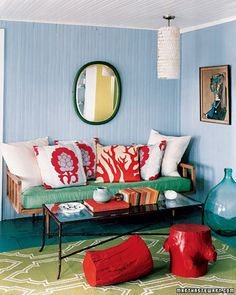 Beach house style- love the DIY stools (tree stumps coated with latex primer + five layers of enamel paint).
