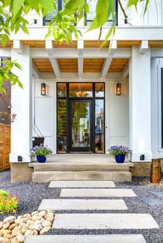 Modern Farmhouse Style-Trickle Creek Designer Homes - tongue and groove wood ceiling on porch. Lovely sconce, surprisingly high location