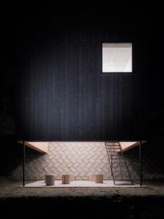 Yoshio Ohno's black timber house straddles a concrete escarpment in Hiroshima