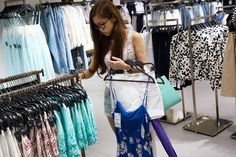 A customer browses clothes at a Zara store in China, on June 24, 2014. (Photo by Lam Yik Fei/Bloomberg/Getty) http://www.msnbc.com/msnbc/analysis-fast-fashion-comes-steep-price-the-environment