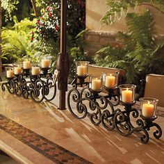 A romantic dinner on your terrace includes a fine wine, evening breezes, and candlelight supplied by our La Scala 2-pc. Tabletop Candelabrum. This beautifully scrolling candelabra is masterfully sculpted to provide just the right amount of aura for your outdoor dining experience.