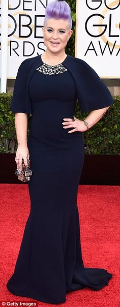 Feeling blue: Kelly Osbourne wore a dark navy gown with jewel detailing at the neck, - love the dress not so much the hair