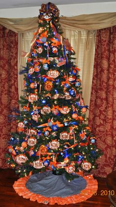 Auburn Christmas Tree.  Made in honor of the undefeated 2010 season.  All of the ornaments are DIY (except the ornament on the tree topper). War Eagle!