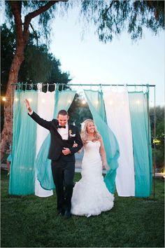 trellis entrances with draping fabric | DIY Wedding Decor Using Fabric & Curtains