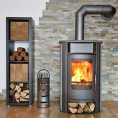 Cleaning wood stove is essential to keep it safe and efficient in burning woods. Learn how to clean your wood stove properly with this guide. Wood, Cleaning Wood, Home, Fire Poker Set, Wood Pellet Stoves, Fireplace Design, Freestanding Fireplace, Stove, House In The Woods