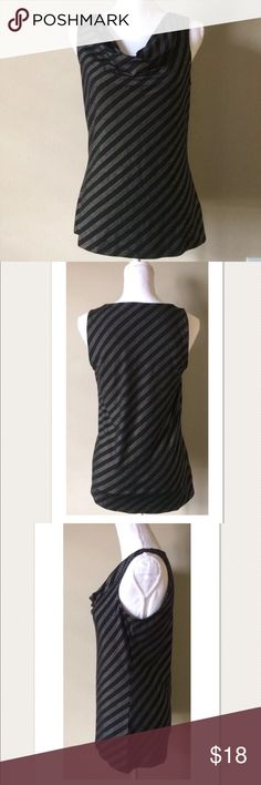 "White House Black Market Striped Drape Neck Top White House Black Market Silver/Black Striped Textured Drape Neck Top ~M~  Great condition!  Black and silver textured stripes Sleeveless Stretch Drape neck style   Size M  Measures approximately: total length 26"" bust across 17.25""  Rayon, Poly, Spandex  PRICED TO SELL FAST! PLEASE ASK ANY QUESTIONS BEFORE PURCHASE, THANKS CHECK OUT MY OTHER DESIGNER HANDBAGS AND CLOTHING! White House Black Market Tops Blouses"