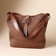 A Generous Bag Of Supple Raffia With Vintage Leather Belts As Straps And Subtle Stud Detailing