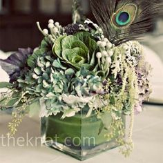 Love this centerpiece + it has a touch of peacock feather flare.