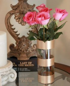For around $3.50, using a few things picked up at the dollar store, you can dress up a basic vase.