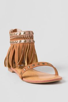 The Python Fringe Sandal are the perfect shoes for the upcoming music festival. These sandals feature a fringe ankle wrap with square studs and a back zip for easy ware. Pair the Python Fringe Sandal with a flowy cream dress and a beaded headband for a boho chic look.