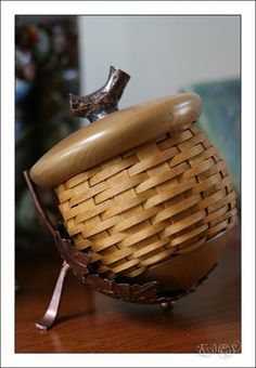 It's not just the acorn shape, its also sitting in a leaf stand~too cool~JN  Longaberger Acorn Basket