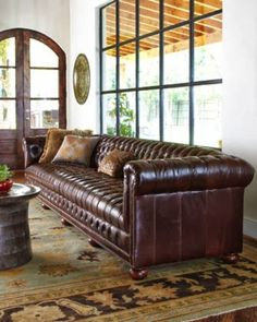chesterfield sofa - all tufted, no cushions, big feet, leather (could be velvet or dark denim)