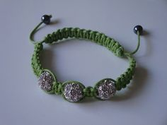 Fashionable handmade lime green shamballa style bracelet with 3 clear stone disco balls (rhinestones). The shamballa style bracelet is adjustable to fit most wrist sizes All my jewellery comes in an organza bag perfect if you are buying a gift for som. Organza Bags, Fashion Bracelets, Lime, Handmade Jewelry, Stone, Blueberries, Green, Gifts, Stuff To Buy