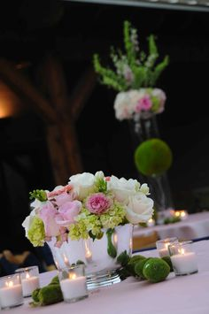 bowl with flowers, votives and moss balls. Something Borrowed Rental can help for a fraction of the cost of buying your decorations