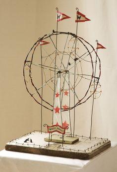A merry go round wire work art.