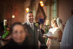 Smiling groom during ceremony at church wedding in Lulworth Dorset #weddingceremony #groom #dorsetwedding
