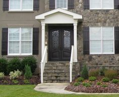 Exterior Exterior Front Door Designs for A Perfect Outer Look: Stag Inside Exterior Front Door Design Idea With Combination Iron And Wooden Black Varnished Double Door Mix White Frame Window Also Big Cutting Stone Stair