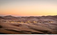 Hotel: Qasr al Sarab Desert Resort, U.A.E. In the heart of one of the largest uninterrupted deserts in the world, guests can ride on camels or mountain bikes over dunes, try their hand at archery, go land sailing or dune bashing through the desert and watch animals graze by the infinity pool.