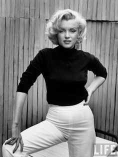 Marilyn Monroe - this is rare picture which shows that she's a strong and confident woman.