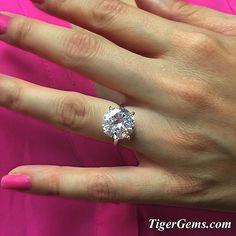 "Another great shot! ""AMAZING! This ring is so gorgeous!  I received so many compliments last night at dinner. Thank you so much Tabitha. I love my new bling!!! ❤"" My client is wearing the 5 carat 4 prong solitaire ring.  Available now at TigerGems.com ✨ Please send me a message at Support@TigerGems.com if you need any help. #handmade #promisering #weddingset#engagementring #bridal #wedding #proposal#datenight #solitairering #diamondring#weddingday #manmadediamond #bride #pinup#gatsby ..."