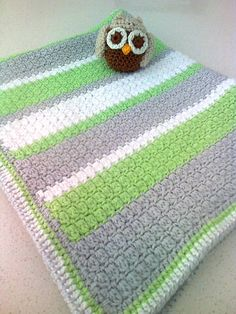 Own design - cluster stitch with three rows of hdc as border finished off with crab stitch edging ... plus a little owl