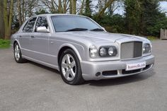 2003-53 Bentley Arnage T Mulliner. Finished in Silver Storm with wing vents and electric sunroof. Soft Black interior stitched in Linen with embossed Flying B's and electric rear seats. Known to ourselves for last 3 years. Only 39,000 miles with Full Service History. Totally unmarked throughout, must be seen. Outstanding value at only £31,250 Full Details:   https://hanwells.net/showrooms/bentley-showroom/bentley-arnage/2003-53-bentley-arnage-t-mulliner-in-silver-storm-31-250