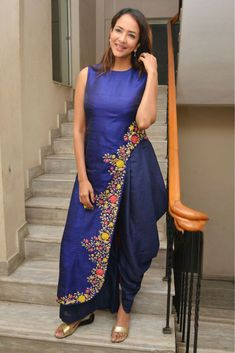The Stylish And Elegant Dhoti Suit In Blue Colour Looks Stunning And Gorgeous With Trendy And Fashionable Fabric Looks Extremely Attractive And Can Add Charm To Any Occasion.This is a completley cust...